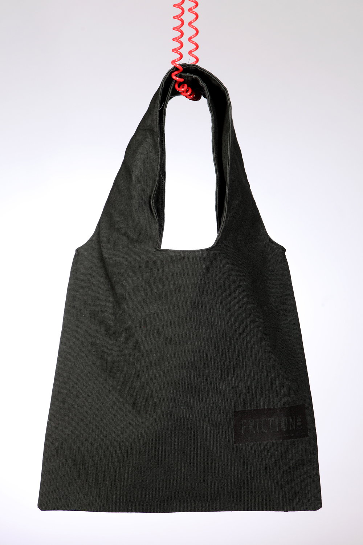 Dark green bag with black label