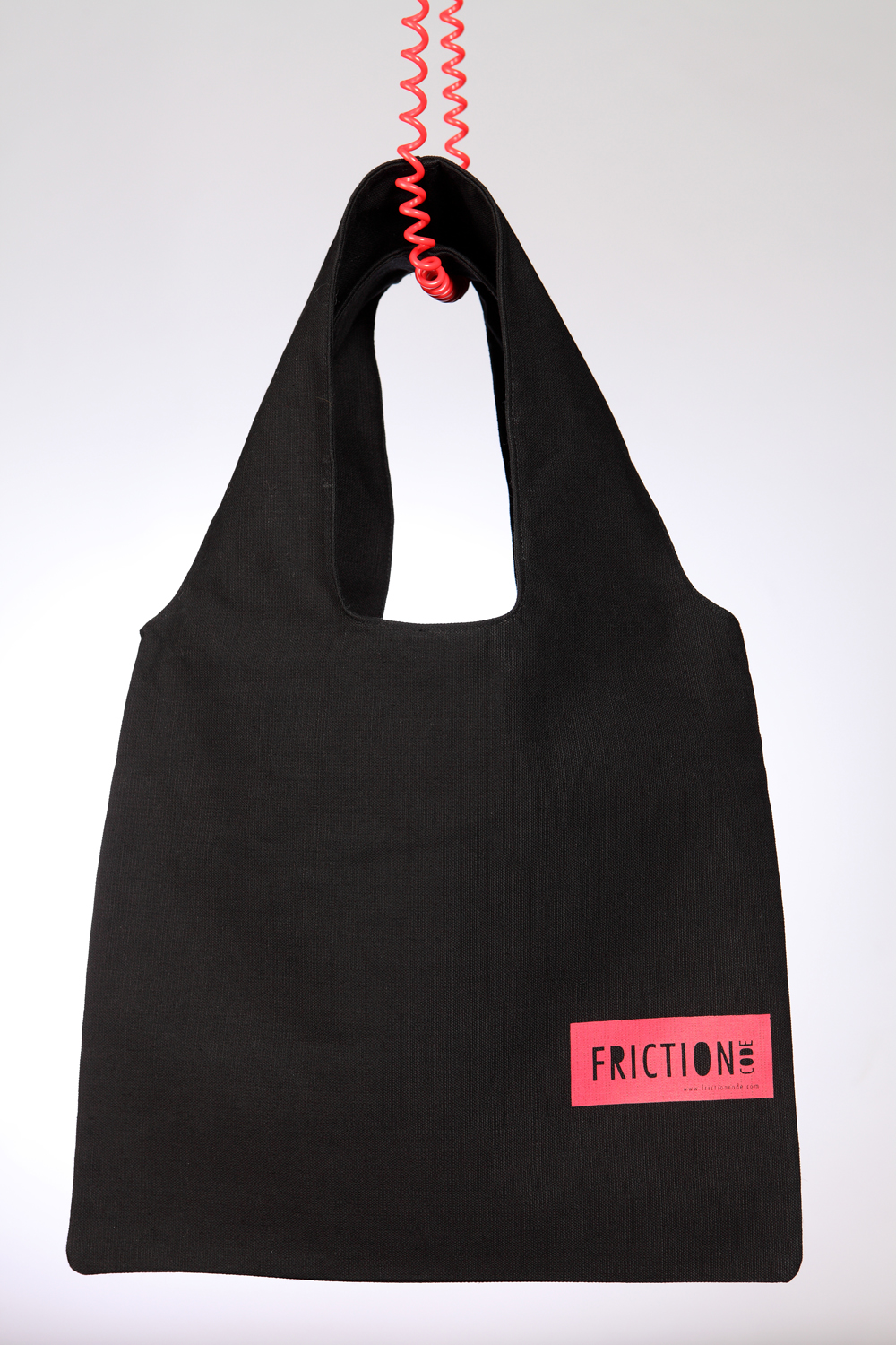 Black bag with red label