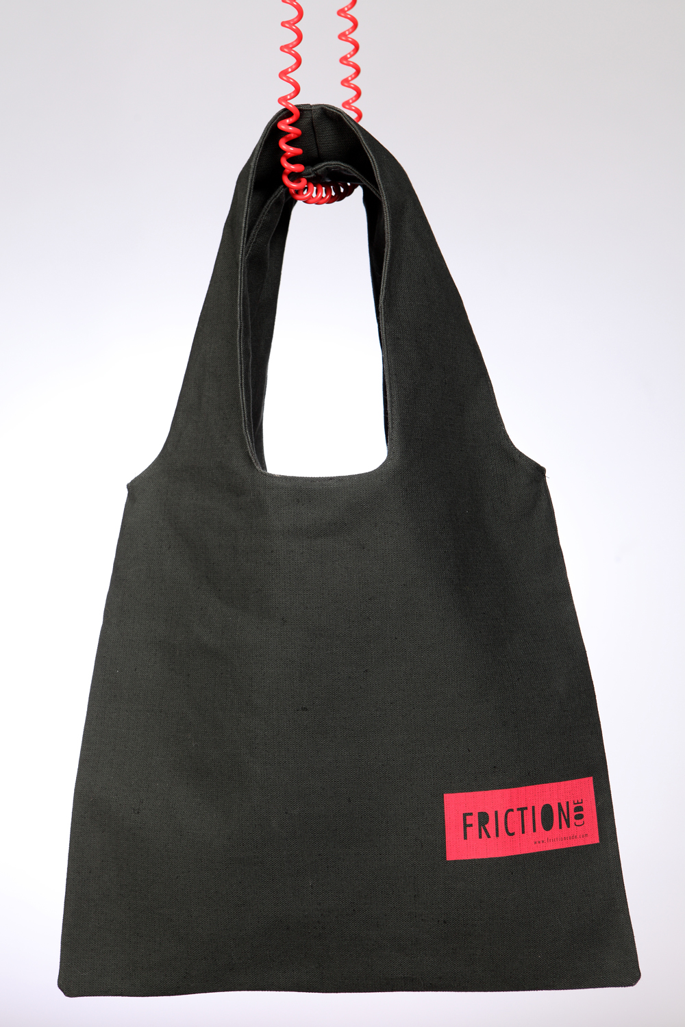 Dark green bag with red label